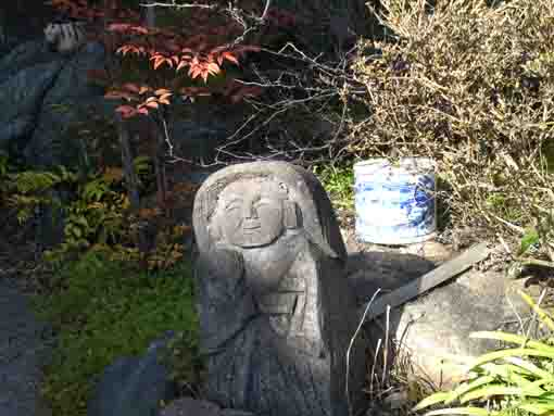 a small statue of Buddha in Zentokuji